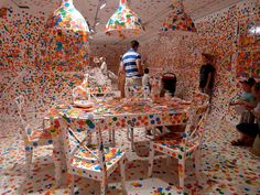 """Giving thousands of kids stickers, artist Yayoi Kusama, created an installation titled """"The Obliteration Room"""" that developed over two weeks at Queensland Gallery of Modern Art. Yayoi Kusama, Room Stickers, Kids Stickers, Land Art, Installation Interactive, Interactive Art, Book Installation, Galerie D'art Moderne, Aryton Senna"""