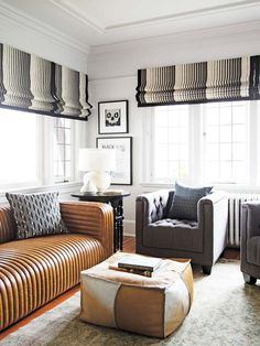 Living room with leather channel tufted sofa on Thou Swell @thouswellblog