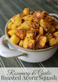 Roasted Acorn Squash Recipe with Rosemary and Garlic - This quick and easy recipe for savory acorn squash uses cubed squash pieces, rosemary, and spices.