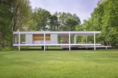 Pictured is the rear of the Farnsworth House, designed by Ludwig Mies van der Rohe. The homes structure is based on three horizontal steel planes lifted out of nature. #dwell #miesvanderrohe #farnsworthhouse