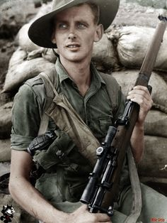 An Aussie Sniper serving in Korea with his SMLE No1 MK III* based rifle, most likely a Lithgow built HT. Image most likely coloured by Mike Gepp.