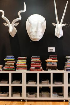 @west elm headquarters and feature on creative director Vanessa Holden // office inspiration // books // black wall