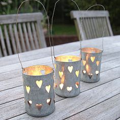 24 Unique Beautiful DIY Garden Lanterns - 13. TIN CANS CANDLE HOLDERS PERFORATED WITH LITTLE HEARTS