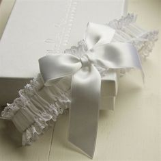 The perfect present for a bride-to-be or special treat for yourself, our elegant and timeless wedding garters make for special keepsakes you will want to cherish.  Playful yet chic, the Boudoir Bow lace bridal garter is fashioned from the finest French lace, adorned with a silk satin bow.  Standard size stretches from 16- 22''. Width approx 4 cm. Contact us for alternative sizes.