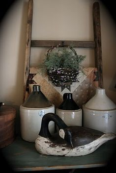 crock jugs and old ladder... love this simple display