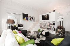 I love the white! It's so bright & airy. I like the elevated bedroom, too. -- loft in Sweden