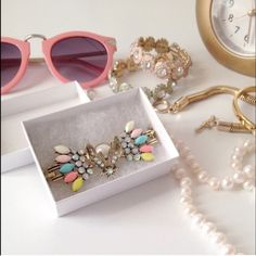 """Pastel beaded pearl bracelet Playful and girly! Unwrap the macaroons and enjoy them while wearing this statement toggle bracelet. Antique gold toned with pastel and iridescent gems. Features a moth or maybe butterfly sitting on a faux pearl. 7.5"""" long. Boutique  Jewelry Bracelets"""