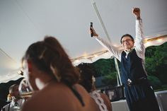 Bride's father celebrates during a speech, by The Rasers.  Wedding in Wildwood, MO.