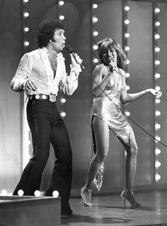 Tina Turner, pictured here in a 1978 concert with Tom Jones, was famous for her sparkly gold minidresses. Tina Turner, Recital, Sir Tom Jones, Tom Jones Singer, Music Icon, Music Is Life, Music Artists, Soul Artists, Rock And Roll