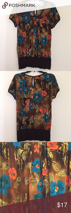 Moa Moa Floral Top Moa Moa floral top, size XLarge. Brown, blue, orange, and green colors. 92% Polyester, 8% Spandex. Moa Moa Tops