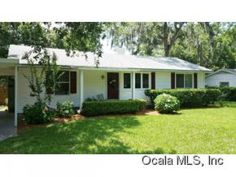 SE Ocala- updated Cottage Style home. Wood floors, updated tile baths, new windows, 2 air-conditioners.  Updated kitchen with gas appliances and Granite tops and island. Large walk-in pantry. Breakfast bar opening out to family room with volume ceiling and French doors with blinds enclosed for easy maintenance. Built in computer center. Real wood floors, split plan. Indoor laundry. Screen enclosed lanai overlooks large backyard. Contact Christi w/ The McCall Real Estate Group 352-547-1077