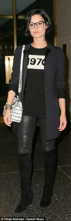 All black: The actress wore a dark coat, boots and leather leggings while out in Manhattan...
