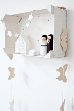 I love this idea! We don't have a lot shelf space down here and we'd need to keep the nativity scene away from destructive hands. This is simple and perfect.