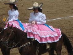"""""""Charreras"""" (the female version of a """"Charro"""" -- a cowboy """"dandy"""") at an exhibition of trick riding in Oaxaca."""