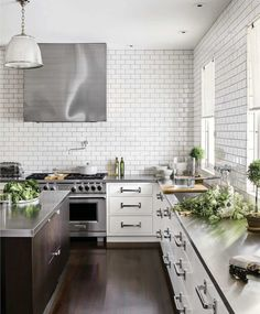 House Beautiful - kitchens - kitchen with no top cabinets, kitchen with no upper cabinets, white cabinets with stainless steel countertops, . Best Kitchen Countertops, Stainless Steel Countertops, Kitchen Tiles, New Kitchen, Kitchen Decor, Kitchen Cabinets, Kitchen White, Concrete Countertops, Stainless Kitchen