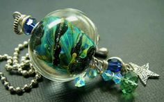Another awesome pendant.  5 Fish Designs - Handmade Fine Jewelry Lampwork & Sterling Silver Pendant.