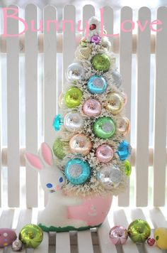 This little guy is all ready to take his place in the Easter Day Parade!!!    Oh so pretty and shabby Easter Bottle Brush tree. These stunning little