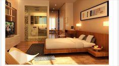 Cama baixa, painel, cama e criados numa peça única. Criados suspensos. Iluminação embutida.