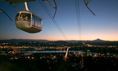 The Portland Aerial Tram climbs 500 feet from the South Waterfront to Oregon Health & Science University's main campus on Marquam Hill. The three-minute ride costs $4 round-trip.