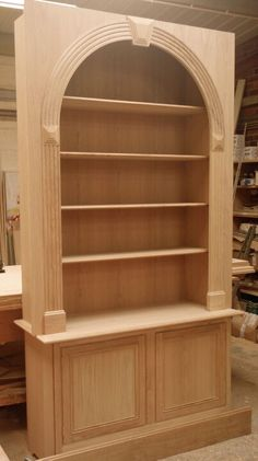 Made to fit an alcove. Made in Oak.