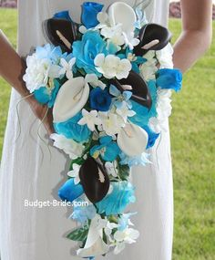 Malibu Blue Wedding Flowers Like the design, but not so much the flowers. Maybe blue orchids, wheat and possibly roses??