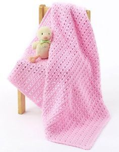 Love easy free crochet afghan patterns? Try this One Skein Baby Blanket. It's a cheap, fun gift to make for any new mom. The soft pink color makes this a great crochet baby blanket for baby girls, but you can also switch up the color and use blue.