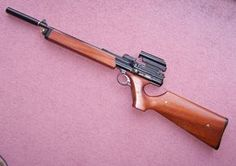 A fantastic Crosman 600 .22 cal semi auto pistol converted to bulk fill C02 rifle.