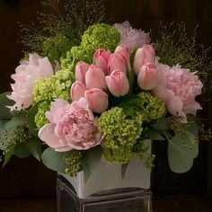Gabriella | A garden of premium springtime classics is all dressed up in shades of blush-pale pink peonies, delicate pink french tulips, and green viburnum...