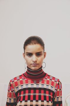 Circle earrings and colour block knit backstage at Jonathan Saunders AW15 LFW. See more here: http://www.dazeddigital.com/fashion/article/23760/1/jonathan-saunders-aw15