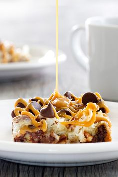 Coconut Caramel Pecan Cookie Bars are a quick and easy treat thanks to refrigerated cookie dough. Pecans, coconut and caramel make them irresistible. Sponsored by Nestle Toll House.