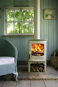 wood burners | Charnwood C-Four multi fuel / wood burning stove store stand model in ...