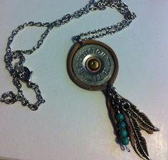 This necklace is dreamcatcher inspired using a 12 guage shotgun shell, leather wrap, feather charms and turquoise beads. Shotgun Shell Crafts, Shotgun Shell Jewelry, Ammo Jewelry, Baby Jewelry, Bullet Jewelry, Jewelry Box, Shotgun Shells, Jewelry Accessories, Jewelry Making