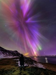 Photographic Print: A Woman Enjoys the Aurora Borealis, Bursting in Colorful Rays. Venus Is at the Lower Right by Babak Tafreshi : 24x18in