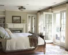 MY DREAM BEDROOM - wood bed tan walls fireplace French doors ivory drapes bamboo roman shades Beautiful traditional bedroom design with tan walls paint French Door Windows, French Door Curtains, French Doors Bedroom, Big Windows, Windows Decor, Dream Bedroom, Home Bedroom, Bedroom Decor, Bedroom Ideas