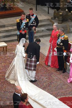 Wedding of Mary Donaldson & Crown Prince Frederik of Denmark May 14, 2004. Mary on the arm of her father, John Donaldson, is almost at the altar to meet her prince.