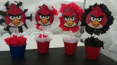 Angry birds kids party.  Tin bucket from the dollar store, tissue paper and mask from party city.