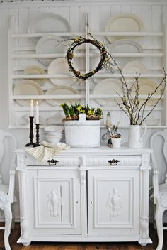 Hanging rack over a chest. White on white.
