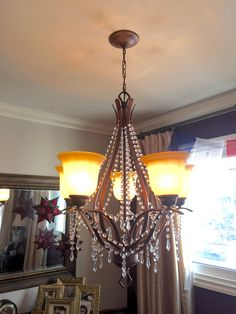 The finished product of an up cycled big box chandelier with married pieces of my old tired one. Ta da!!