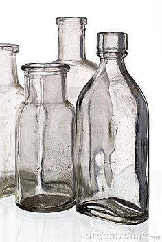 Vintage medicine bottles by Graeme Dawes, via Dreamstime