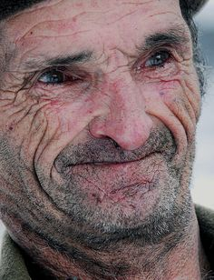 I love the stories written in the lines and expression on this man's face.  Wish I could read them.  rusty
