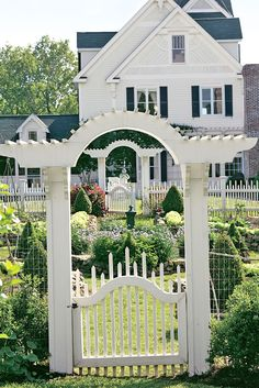 This shows a traditional house with wonderful Garden Gates.