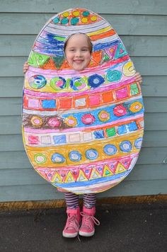 Turn your child into a laughing, dancing giant Easter egg - scissors, paper, glue, a sheet of cardboard, some crayons and a child is all you need!