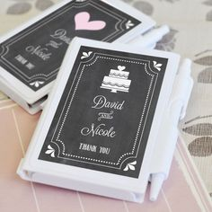 Chalkboard Wedding Personalized Notebook Favors. Today is the day that you and your other half get to share your love story with friends and family. After a beautiful ceremony and a joyful reception, your guests can keep the memories alive with these Chalkboard Wedding Personalized Notebook Favors. Each white notebook contains blank sheets of paper and a pen that also serves as a handy way to keep the notebooks sealed when stored in purses and pockets. These practical favors make a great…