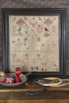 """Sarah Boothman 1845 is the title of this reproduction sampler cross stitch pattern from Heartstring Samplery. The model is stitched on 20 Ct Weeks Dye Works Straw Linen stitched with one thread over two that winds up being 20"""" x 23"""" finished size. The designer also stitched with wool fibers."""