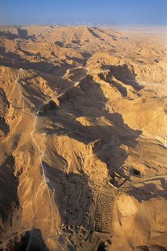 Deir el-Medina, from above. The picture features an overhead view of Deir el-Medina, surrounded by the rugged Theban mountains. To the left of the settlement may be the necropolis of workers. Aerial view, Egypt