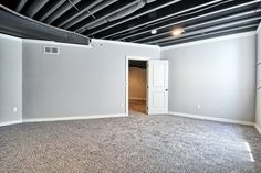 13 Clever Unfinished Basement Ideas on a Budget, You Should Try! 13 Clever Unfinished Basement Ideas on a Budget, You Should Try! Basement Layout, Basement Windows, Basement Walls, Basement Bedrooms, Basement Flooring, Basement Bathroom, Unfinished Basement Ceiling, Unfinished Basements, Basement Black Ceiling