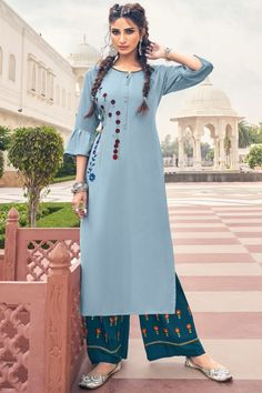 Featuring beautiful embroidery, this sky blue rayon trouser suit which will make your look very subtle yet edgy. This round neck and 3/4th sleeve apparel prettified with resham work. Paired with rayon palazzo pant in persian green color with persian green chiffon dupatta. Palazzo pant has resham work. Dupatta designed with plain work. #trousersuit #salwarkameez #malaysia #Indianwear #Indiandresses #andaazfashion Blue Trousers, Trouser Suits, Palazzo Suit, Kurta Palazzo, Women Salwar Suit, Light Blue Dresses, How To Dye Fabric, Dress Suits, Indian Dresses