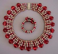 HASKELL cranberry glass beads in four sizes (melon, round and disk shaped) and clear rhinestone bars comprise this by collar necklace and by coil bracelet with safety chain. Antique Jewelry, Beaded Jewelry, Vintage Jewelry, Fine Jewelry, Jewelry Ads, Vintage Costume Jewelry, Vintage Costumes, Miriam Haskell, Beautiful Costumes