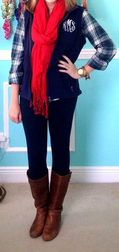 Plaid shirt, navy flannel monogram vest, red scarf, dark wash skinnies, and brown boots.