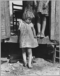 """""""On Arizona Highway 87, south of Chandler. Maricopa County. A migratory family living in a trailer in an open field. No sanitation, no water.  They came from Amarillo, Texas. Pulled bolls near Amarillo, picked cotton near Roswell, New Mexico, and in Arizona. Plan to return to Amarillo at close of cotton picking season for work on WPA.  11/1940"""" - Dorothea Lange"""